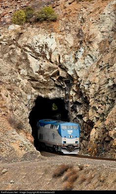 Amtrak 71 leads the AAPRCO Napa Valley Limited through the Feather River Canyon as it exits a natural tunnel west of Belden, California.