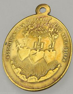 Triple sacred heart medal of the hearts of Jesus, Mary and Joseph.