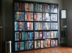 DVD and Xbox game storage wall in man cave.