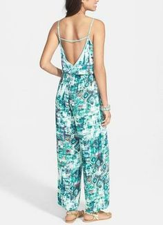 Can't get enough of this green geometric print jumpsuit. In love with the open back.