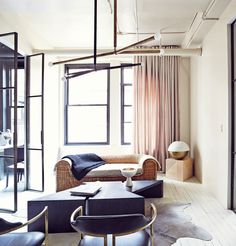 Neutral living space with modern ligthing and furniture // Apparatus Studio Home