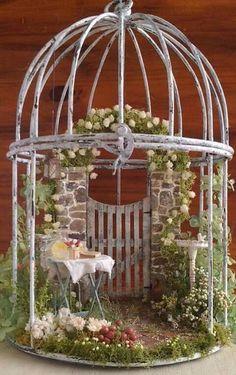 Lovely little birdcage mini-garden.