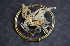 Tick, tock...this mockingjay pin is a clock...I need this!