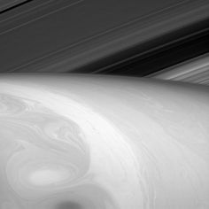 A sublime picture of Saturn's clouds taken by the Cassini-Huygens mission shows swirls of material mixing like paint in water or cream whirling through coffee.