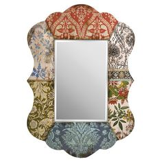 Wall mirror with a damask-inspired patchwork frame.   Product: MirrorConstruction Material: MDF and mirrored gla...Homespun Elegance Collection (Joss & Main)