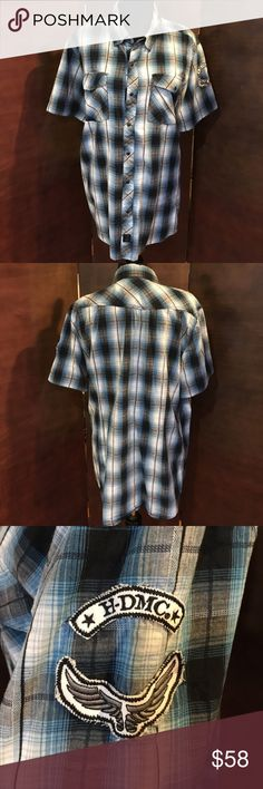 Harley Davidson Blue Plaid Button Down Shirt Harley Davidson Blue Plaid Button Down Shirt. The buttons are snap buttons. Blue, black and white plaid pattern. Patch on left arm. Gently worn.  Harley Davidson Plaid Harley-Davidson Shirts Casual Button Down Shirts