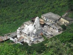 Shikharji , Giridih district, Jharkhand, India, is located on Parasnath, the highest mountain of the Parasnath Range. It is a Jain Tirtha (pilgrimage site) believed to be the place where twenty of the twenty-four Jain tirthankaras along with many other monks attained Moksha, according to Nirvana Kanda and other texts.