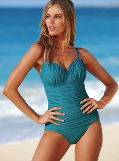 Another retro swim suit. This is how I always pose at the beach, too.
