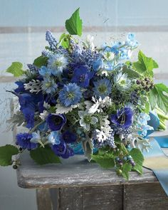 Browse blue bouquet options in various styles and blooms.  An exuberant cluster of nigella, anemones, and muscari, along with porcelain berries and dusty miller, is a celebration of blue, from the palest sky to the deepest twilight.