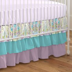 """Crib Dust Ruffle in Aqua and Purple Jasmine by Carousel Designs.  Layer up with our flowing three-tiered crib skirt, perfect for hiding unsightly crib hardware and for putting the final touch on your crib. Finished length approximately 18 inches. Fits standard cribs using mattresses measuring approximately 28"""" x 52"""". Dry clean only."""