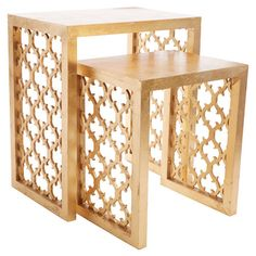 A stylish addition to your living room or den, this eye-catching nesting table set showcases an openwork quatrefoil design and matte gold finish.