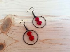 Dark golden hoop earrings with red orange Czech glass beads; Orange and gold earrings; Red and gold hoop earrings; Glass and metal earrings by CraftingAwayTheFeels on Etsy