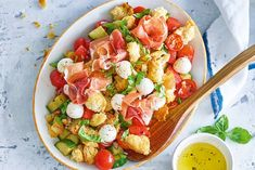Salty prosciutto balances the sweetness of watermelon and sherry vinegar in this twist on an Italian bread salad.