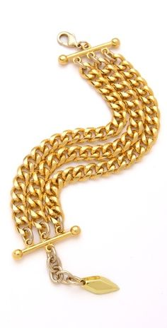 bracelet of three curb-chain strands wraps around the wrist, held together by polished bars. A small adjustment chain attaches to the lobster-claw clasp