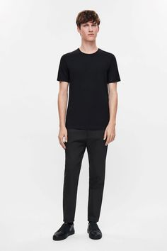 COS image 1 of Tapered slim trousers in Black