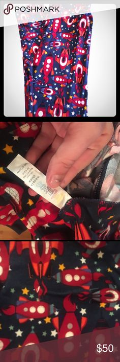 LuLaRoe space ships stars and rockets TC leggings Red tickets on navy blue background with stars. Made in China. Size tall & Curvy. NWT. LuLaRoe Pants Leggings