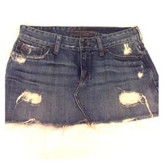 Abercrombie and Fitch Jean Skirt Distressed jean skirt. See second picture for style suggestion. Pictures 1,3, and 4 are of actual skirt. Abercrombie & Fitch Skirts Mini