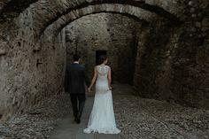 Bride and Groom walking in an Italian Castle