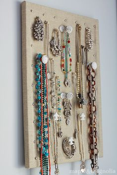 Jewelry holder made from cheap cork board. I need to do this!