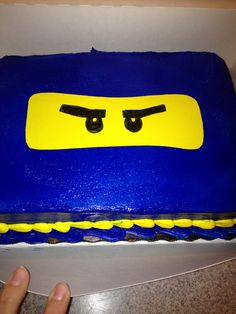 Easy Ninjago Cake Store bought cake we had airbrushed  Sugar sheet and food color markers for the eyes/face