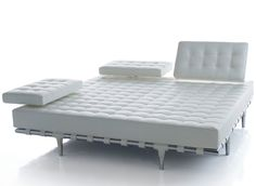 Privé (white leather) by Philippe Starck.