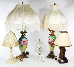Lot 712: Table Lamp Assortment; Including a slag glass floral lamp, two painted porcelain and metal ewer lamps, a glass lamp and a golf themed lamp