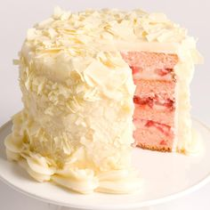 Hello, overnight shipping. :)    This perfectly pink Strawberry cake is loaded with strawberry icing fruit, then separated by layers of cream cheese frosting and fresh strawberry slices. The finished product is covered with cream cheese frosting and topped with white chocolate curls. A deliciously decadent fruity dessert!
