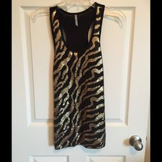 Sequined tank top Sequined Tank top in gold and black. Size - medium. New without tags. Tops Tank Tops