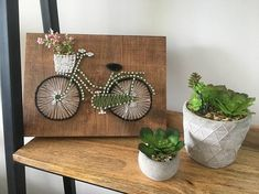 This bicycle string is 12x7 inches. This string art is perfect for hanging on a wall or leaning on a shelf. This is a great piece for any room throughout the home. As well as this string art is a perfect gift this holiday season either for yourself or someone else. The string art