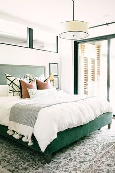 Gorgeous room with dark green upholstered bed