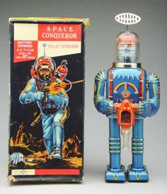 "Tin Litho Battery-Operated Space Conqueror. Japanese. Made by Daiya. Some minor crazing to the battery containers on back and the antenna is a reproduction. Also, one very small and minor stress line to dome. Includes original box with one corner tear and some paper lifting on bottom left-hand corner. Box appears to be complete.  Condition Toy (Excellent) Box (Excellent). Size 10 - 1/2"" T."