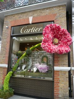 Cartier window display. Now that's how to use poms!