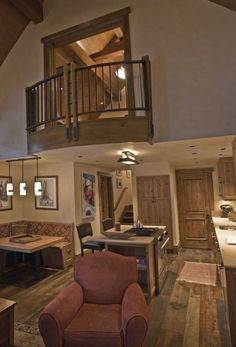 I like the lofted bedroom with a balcony overlooking the fireplace and open-ceiling living room.
