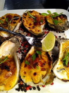 Get the recipe: BBQ Baked Oysters with Bacon Powder and Ararat by MCC Chef Marc Forgione #macys #recipe