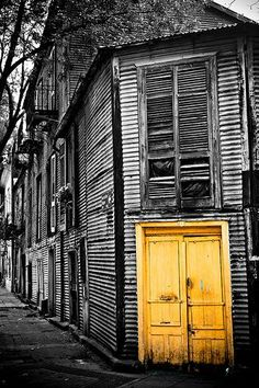Buenos Aires Yellow doors suggest an inviting, welcoming interior belying the forlorn exterior.