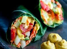 19 Delicious, Bread-Free Veggie Wraps: Collard Wraps with Turmeric Dressing with red bell pepper, carrot, cherry tomatoes, cucumber