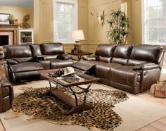 This motion sofa and loveseat combination is large and plush with a heavy steel mechanism for easy operation and durability. The back, seat, and ottoman move in unison so you can find your own personal comfort position. Rich, brown bonded leather is accented with contrast stitching for a clean, attractive look. ($1398)