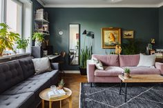 Living room with green wall and pink sofa