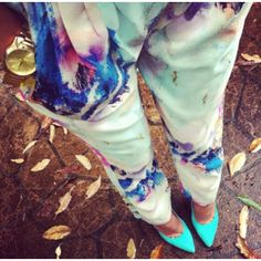 pastel blue pumps, and tie dyed trousers.