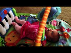 Playing with Fisher Price Discover N Grow Kick & Play Piano Gym