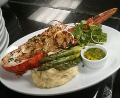 Chef William's Famous Crab Stuffed Lobster with Asparagus and Smashed Potatoes $23.50.  ON SUNDAYS...1LB ALASKAN SNOW CRAB LEGS WITH SIDES FOR $15.95