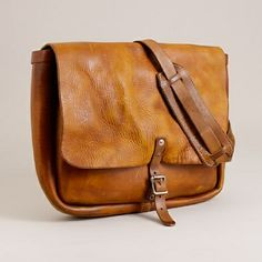 'The original' leather postal messenger bag. make the flap longer and lose the buckle and it's golden