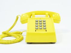 Vintage telephone yellow push button phone