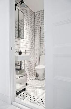 white + mirrored cabinet