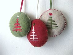 NOTICE: ALL ITEMS ORDERED BETWEEN NOW AND NOVEMBER 13 WILL SHIP ON TUESDAY, NOVEMBER 13. This is a set of three hand-made felt ornaments with hand stitched tree designs. Stitching is dark green, eggshell white, and dark red, with matching ribbons as shown. Each ornament has the same design on both sides (front and back).  Each ornament is about 2.5 inches. Handmade in a pet-free and smoke-free environment. Free gift wrapping upon request. All items ship within two business days.