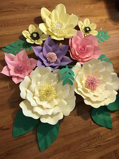 This listing is for a arrangement as picture with custom color any of your choose.  2 Large 17-20 in diameter 2 Medium 14-16 diameter 2 Small. 10-12 diameter 2 mini. 7-9 diameter Leaves+    Specialty paper such as metallic, glitter and pattern are additional.