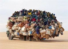Escape from Sudan. We have it so good. We have no idea. This image makes me think of the word 'stark' for some reason.