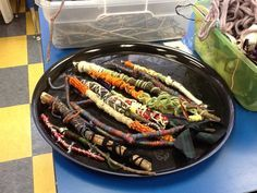 A different kind of weaving...wrapping sticks. Great fine motor skills.