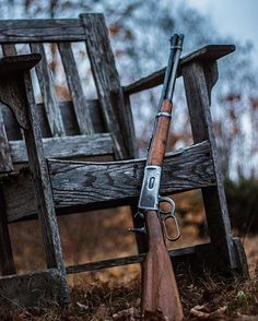Lever action rifle against old chair. Great shot. @karaphotographycanada