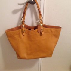 Authentic Coach mustard yellow bag In excellent used condition. No rips or stains. Authentic with zipper and two side parts. All snaps shut. Coach Bags